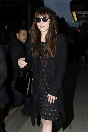 Noomi Rapace hid her eyes behind a pair of John Lennon-inspired sunnies as she headed to a dinner party.