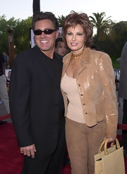 Raquel Welch teamed up her look with a brown beaded layered choker.