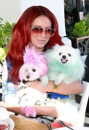 Aubrey O'Day maintained her pastel look in rose-tinted glasses.