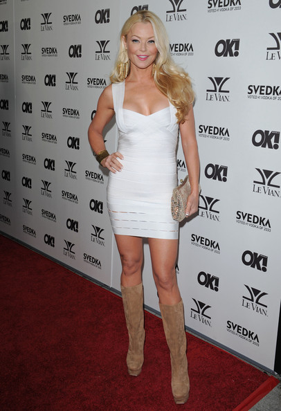 Charlotte paired her suede knee high boots with a white bandage dress.