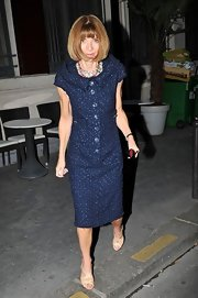 Anna Wintour finished off her blue tweed outfit with strappy nude heels.