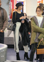 For her footwear, Olivia Culpo chose a pair of black suede ankle boots by Aquatalia.