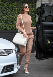 Olivia Culpo was matchy-matchy chic in her tan knit separates.