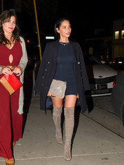 Olivia Munn matched her boots with a zigzag-patterned suede clutch.