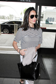 Olivia Munn completed her look with a pair of black aviators.