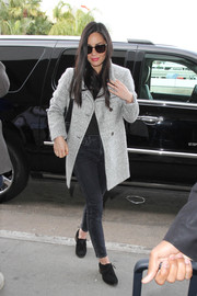 Olivia Munn looked chic wearing a soft grey wool coat over her dark wash denim jeans that she paired with ankle oxford boots at LAX.