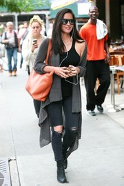 Olivia Munn took a stroll in New York City wearing an oversized gray shawl-collar cardigan.