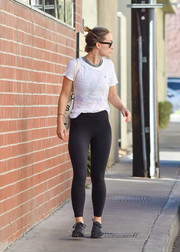 Olivia Wilde completed her comfy outfit with a pair of black leggings.