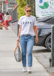Olivia Wilde teamed her tee with classic blue jeans.