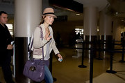 Olivia Wilde made her way through LAX airport toting a patent leather shoulder bag.