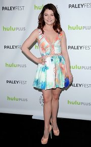 Emilie De Ravin showed her playful side with a multi-colored cocktail dress with full skirt.