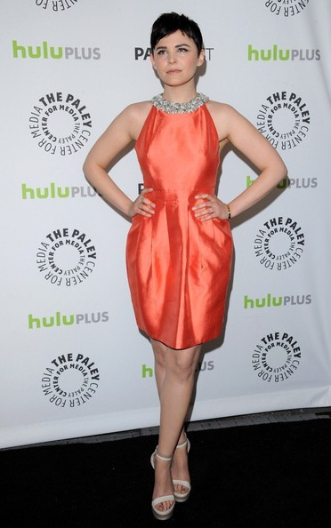 Ginnifer Goodwin showed off her curves in a coral sleeveless dress with beaded neckline.