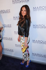 Minka Kelly carried this yellow clutch with her eclectic ensemble on the red carpet of the Marquee Night Club opening in Australia.