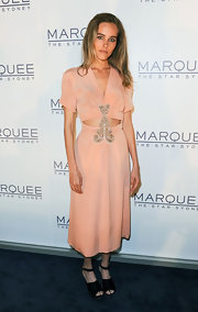Isabel Lucas wore this silky peach cutout dress with an embroidered applique to the opening of Marguee Night Club in Australia.