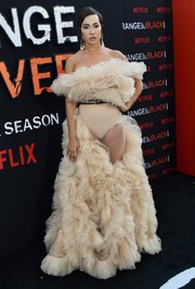 Jackie Cruz stole the spotlight in a partially sheer, off-the-shoulder ruffle gown by LOULOU at the premiere of 'Orange is the New Black' season 7.