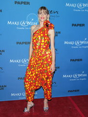 Jaime King completed her funky ensemble with silver knot-detail platforms by Giuseppe Zanotti.