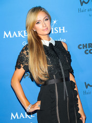 Paris Hilton paired a beautiful diamond bracelet with a collared LBD for the Paper Magazine Runway Benefit.
