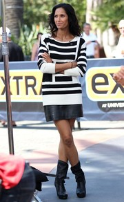 Padma Lakshmi visited 'Extra' wearing a chic black-and-white boatneck sweater.