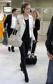 Barbara Palvin swung around a white leather bowler bag with roomy pockets as she prepared to leave Cannes.