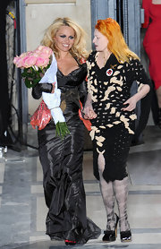 Vivienne Westwood was her usual flamboyant self in a black dress featuring multiple cutouts during her fashion show.