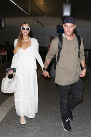 Paris Hilton was spotted at LAX looking boho-sweet in a white maxi dress with a sweetheart neckline.