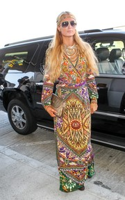 Paris Hilton topped off her showy ensemble with a metallic gold clutch.