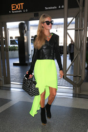 Paris Hilton was hard to miss at LAX in her black leather jacket and neon dress combo.