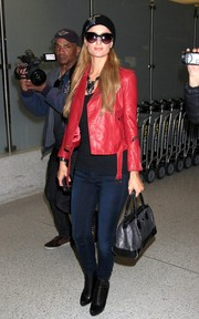 Paris Hilton looked every bit the chic jet setter in a red leather jacket and skinny jeans as she arrived at LAX.