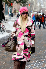 Paris paired her loud print jacket with a matching bow-adorned beanie for her stroll through aspen.