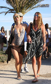 Paris loves her monokinis. The heiress partied at Nikki Beach in a leopard-printed version with a Louis Vuitton wrap.