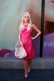 Paris Hilton complemented her elegant pink frock with taupe patent pumps.
