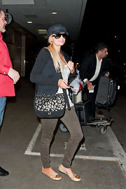 Paris Hilton traveled in comfort in a pair of nude Tory Burch flats.