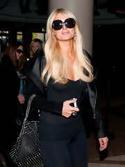 Paris Hilton covered her eyes, but not her smirk, in a pair of oversized black sunglasses.