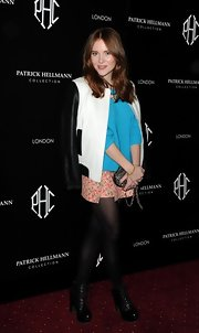 Angela Scanlon opted for a bright pink floral skirt to pair with her blue sweater at the Patrick Hellmann launch party.