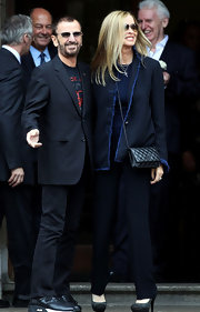 Barbara Bach wore a striped black blazer with frayed blue edges to Paul McCartney's wedding.