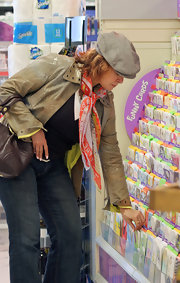 Raquel Welch wore a gray newsboy hat while out shopping in LA.
