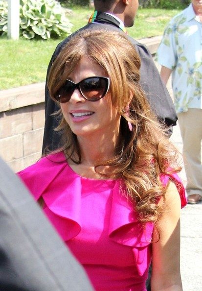 Paula Abdul wore her hair half up with long tousled curls and casually side-swept bangs.