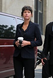 Paz de la Huerta looked subdued in a fitted navy pinstripe jacket as she left the Manhattan Criminal Court.
