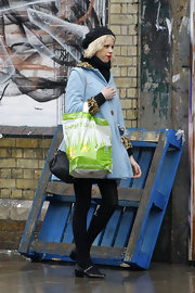 Peaches Geldof opted for quirky winter wear in a powder blue swing coat with leopard print trim.