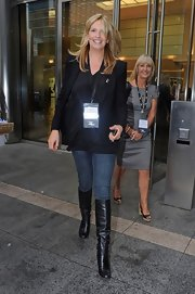 Penny Lancaster was spotted leaving the KGC charity event in her knee-high leather boots.
