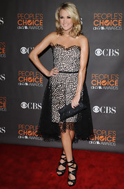 "Carrie chose the simple, black, ""Louise"" crocodile clutch for this intricate, overlaid cocktail dress."