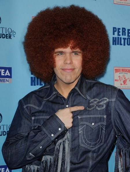 Perez Hilton completed his '70s-themed birthday party costume with an enormous Afro wig.