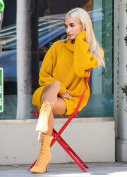 Pia Mia brightened up the sidewalk with this mustard sweater dress while doing a photo shoot.