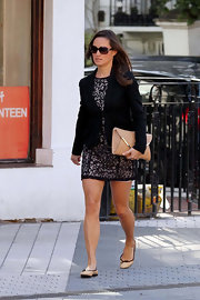 Pippa Middleton was out and about in London in a chic lace dress paired with ballet flats and a beige envelope clutch.