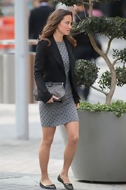 Pippa Middleton showed off her chic street style in a printed sweater dress paired with the 'Sweetie' animal-print frame clutch.