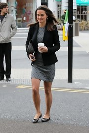 Pippa Middleton takes to work in a chic polka-dot dress paired with classic black ballet flats.