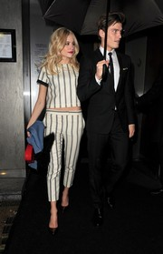 Pixie Lott flashed a bit of abs in a monochrome striped crop-top while enjoying a date night.