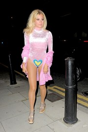 Pixie Lott was a head turner on the streets of Soho in a pink bodysuit with a strategically placed heart.