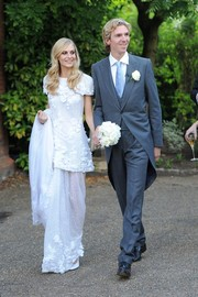 Poppy Delevingne wore a romantic Chanel Couture wedding dress to marry James Cook complete with floral embroidery and a sheer skirt.