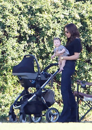 Victoria Beckham took her little princess to watch soccer in a pair of '70s inspired flares.